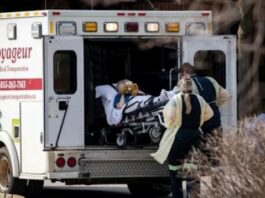Paramedics transport a resident from Midland Gardens Care Community in Toronto